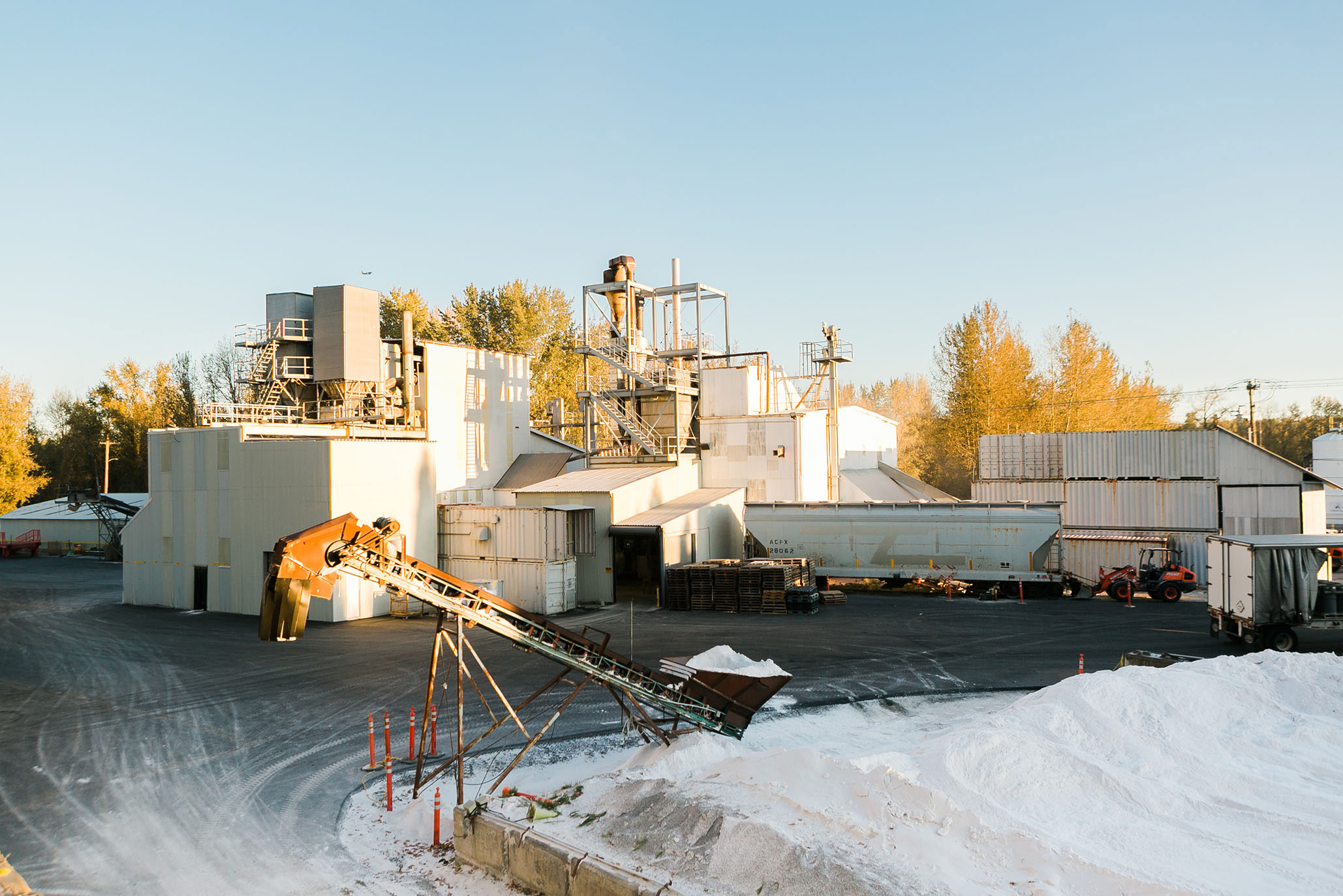 The Supreme Perlite Factory with a crane full of perlite
