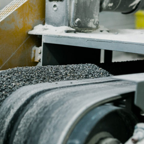 Perlite running off a conveyor belt