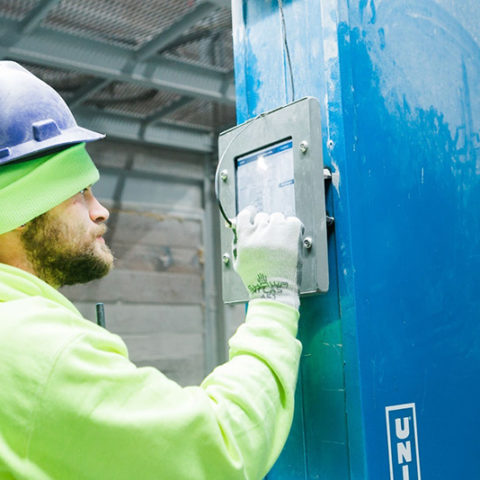 Factory Worker Operating Perlite Equipment