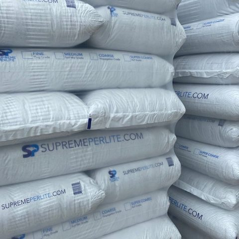 Supreme Perlite product bags stacked on on top of each other